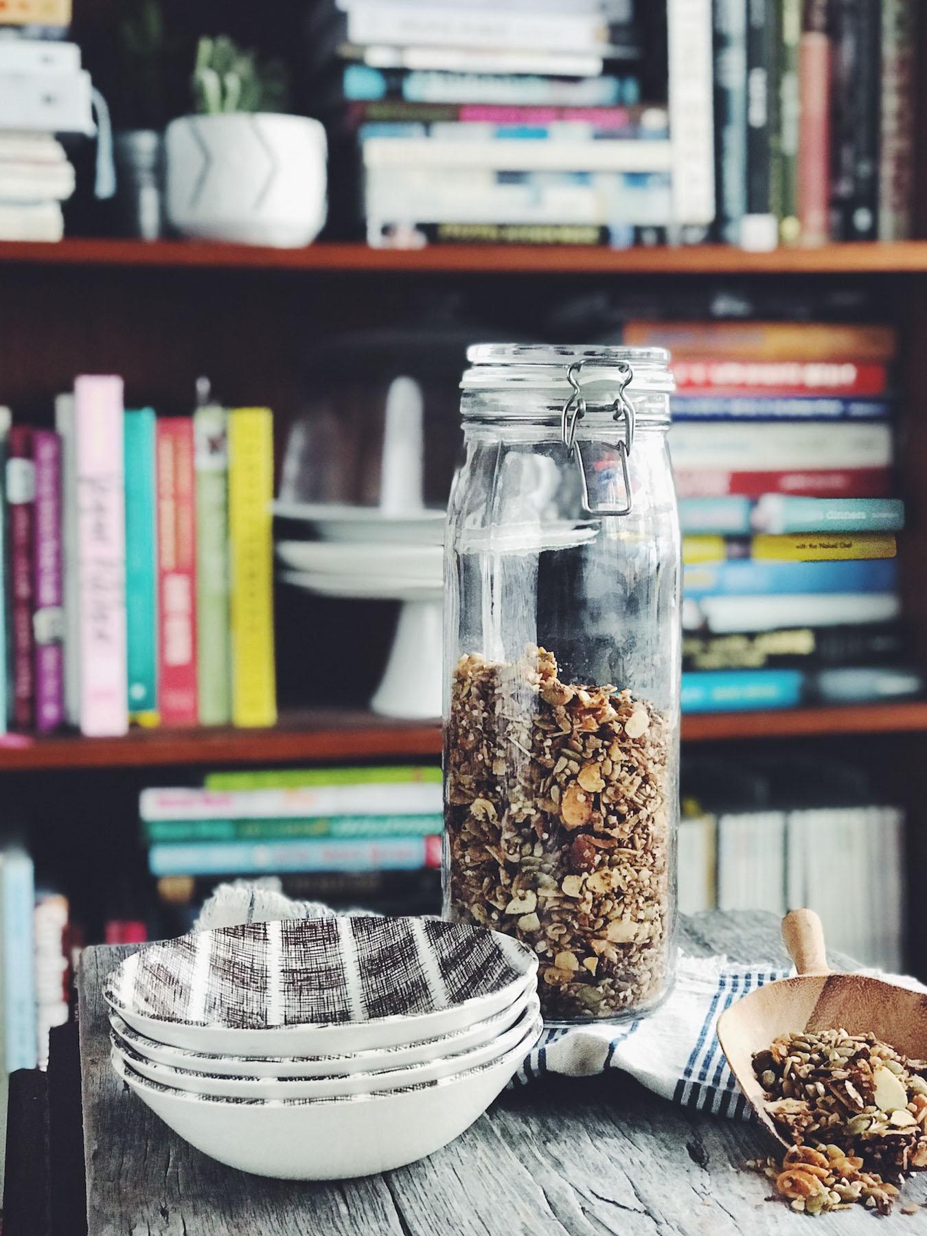 A jar of nutty seedy baked granola.