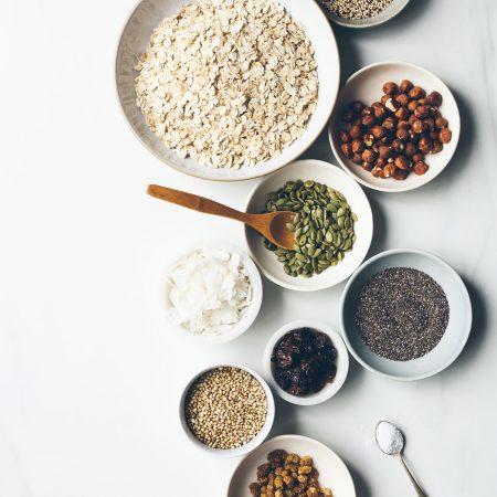 Overhead shot of bowls of ingredients for making granola