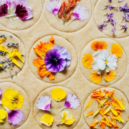 Cookie dough cutouts topped with edible flower petals.
