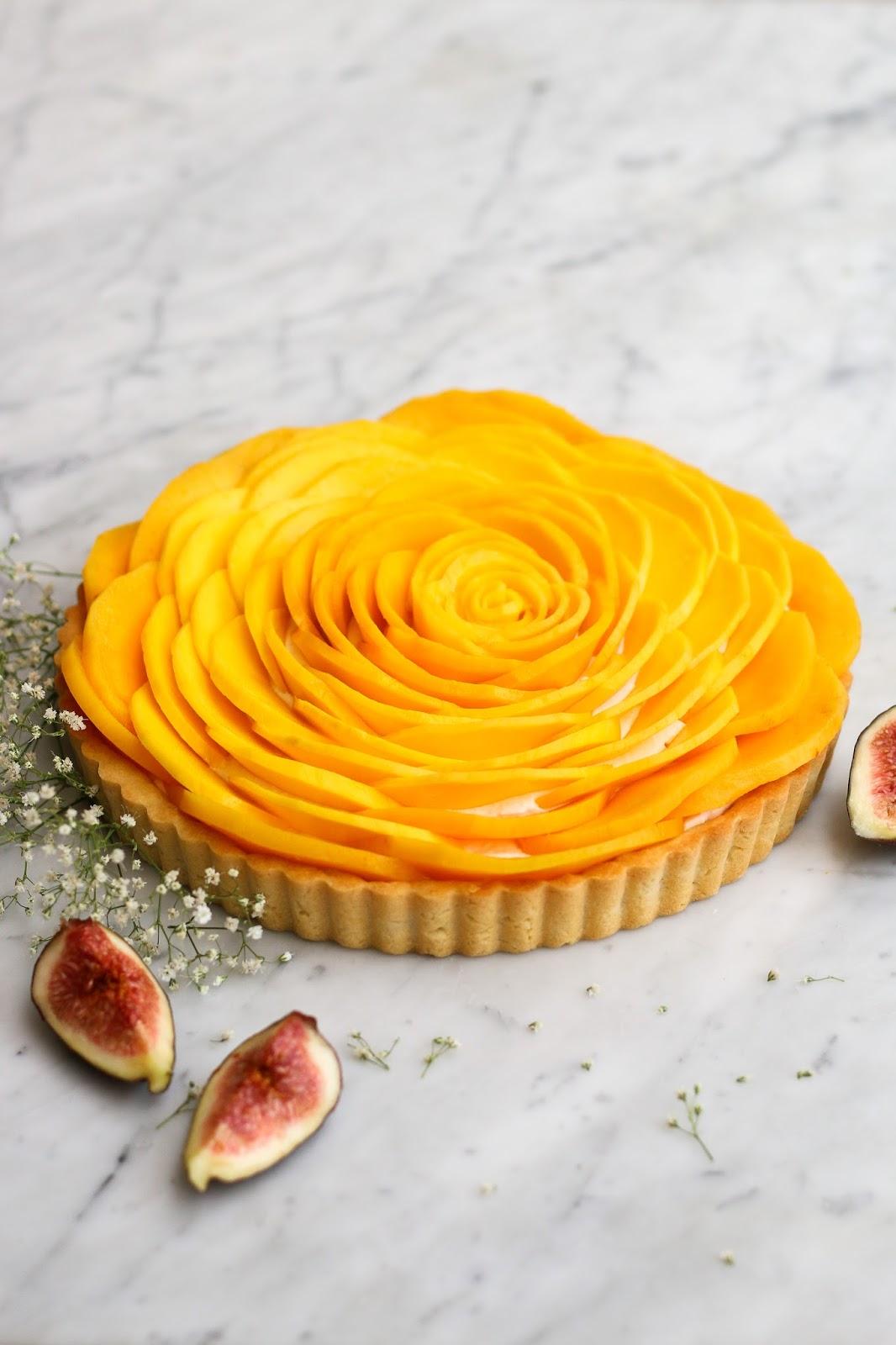 Side angle shot of mango fruit tart.