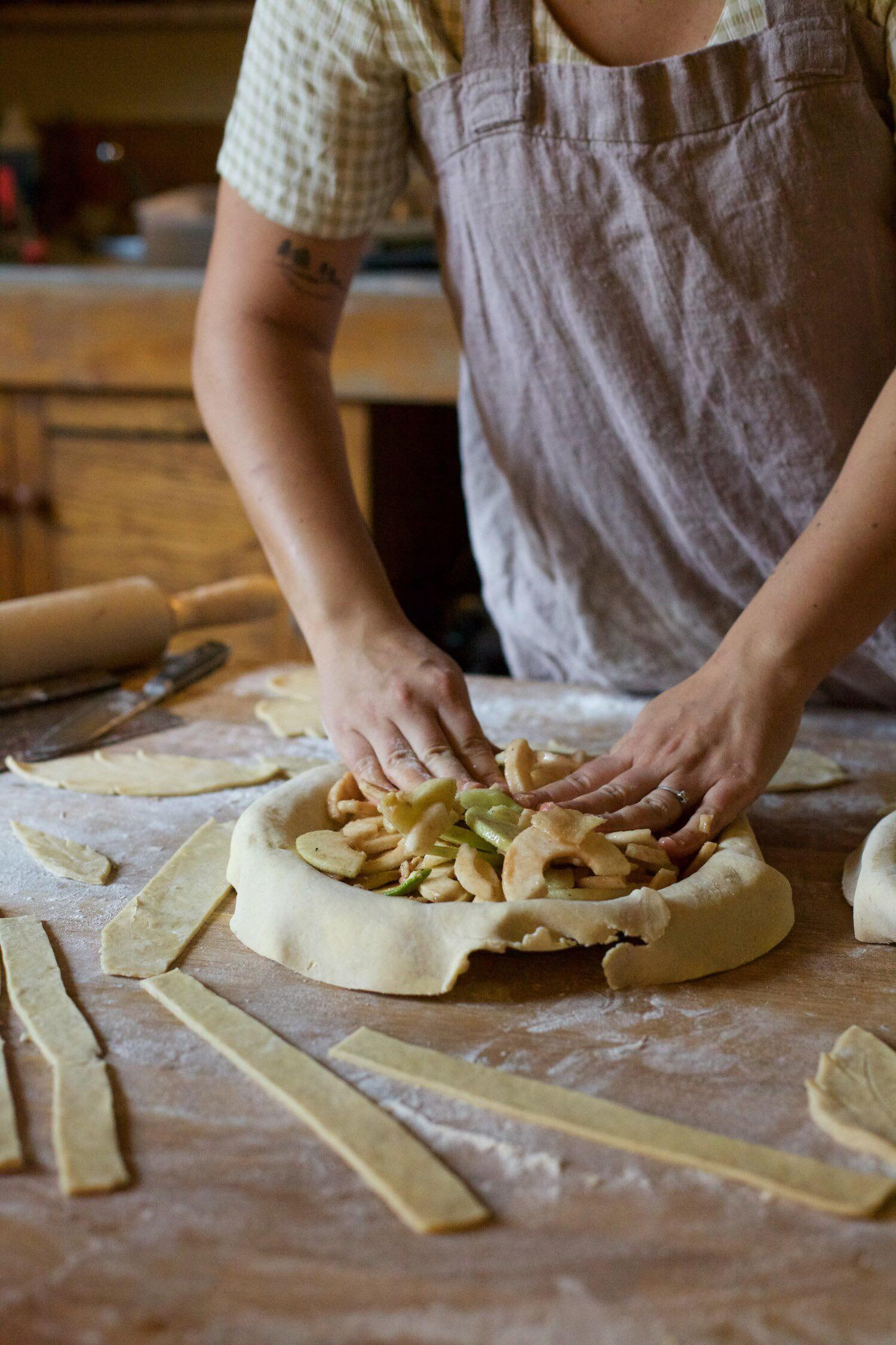 Straight on shot of a person making a pie