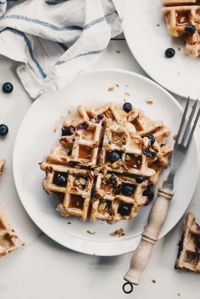 Overhead shot of granola rye waffles on a table