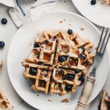 Overhead shot of granola rye waffles on a table.