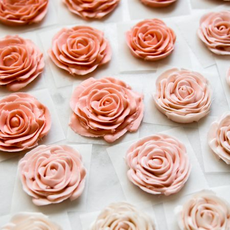 Buttercream roses in colour gradient, from dark pink at the back to light at the front.