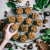Pumpkin Spice Breakfast Cookies on black wire rack with marble background and fall leaves and nuts