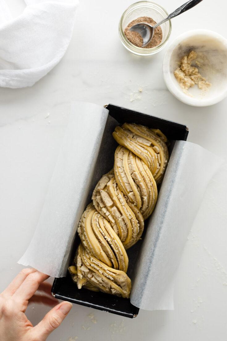Shot of white chocolate cardamom babka dough in a pan.
