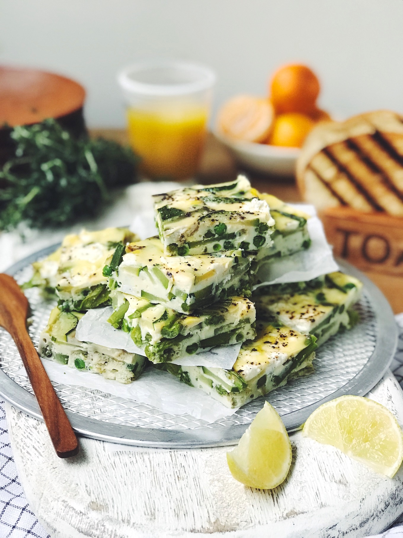 Close-up shot of squares of Asparagus and Goat Cheese Frittata on a plate