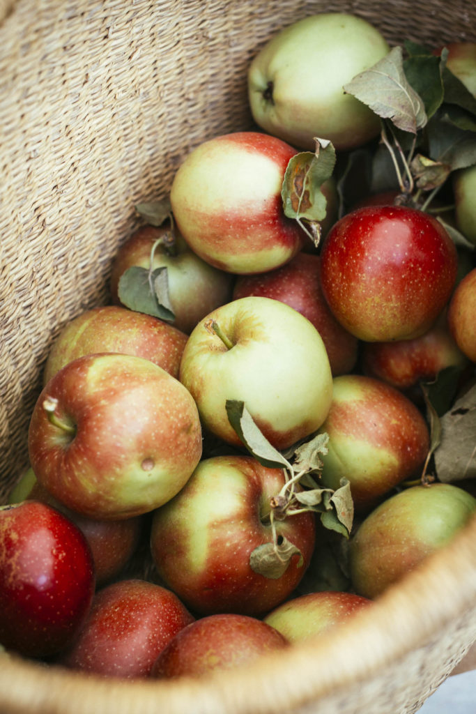 Close up of apples in a basket.