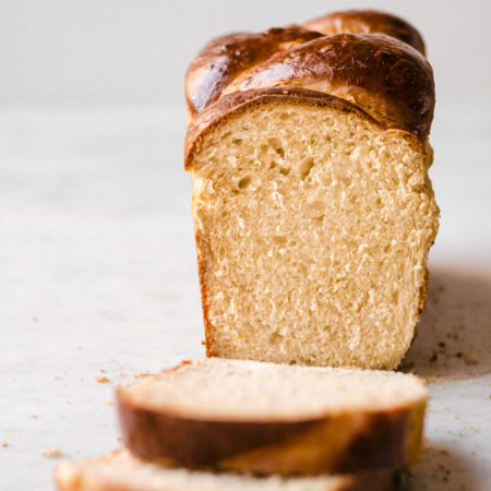 Head on image of brioche bread with two slices taken off.
