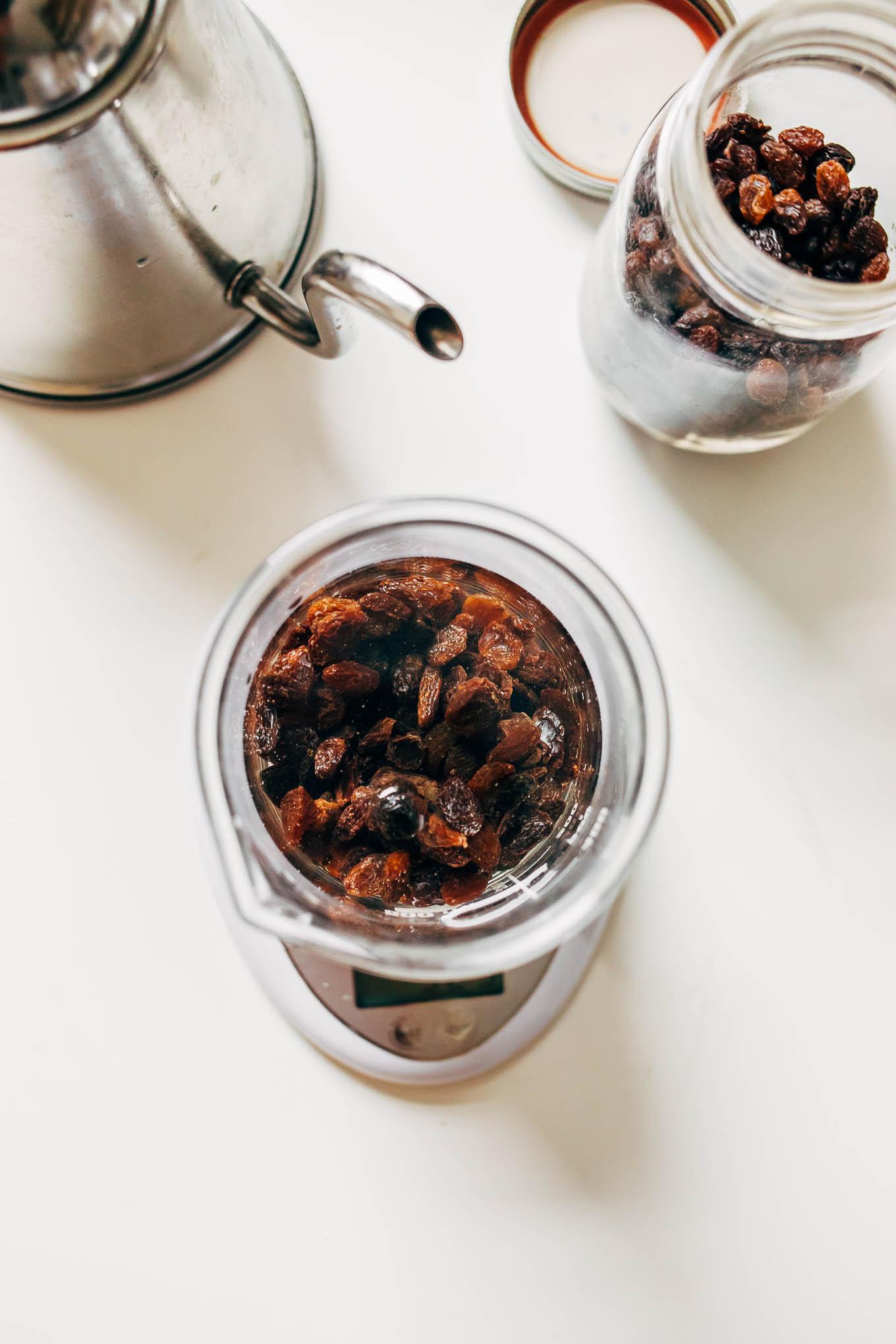 overhead image jar of raisins on a white background.