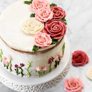 Lemon cake with buttercream roses on top.