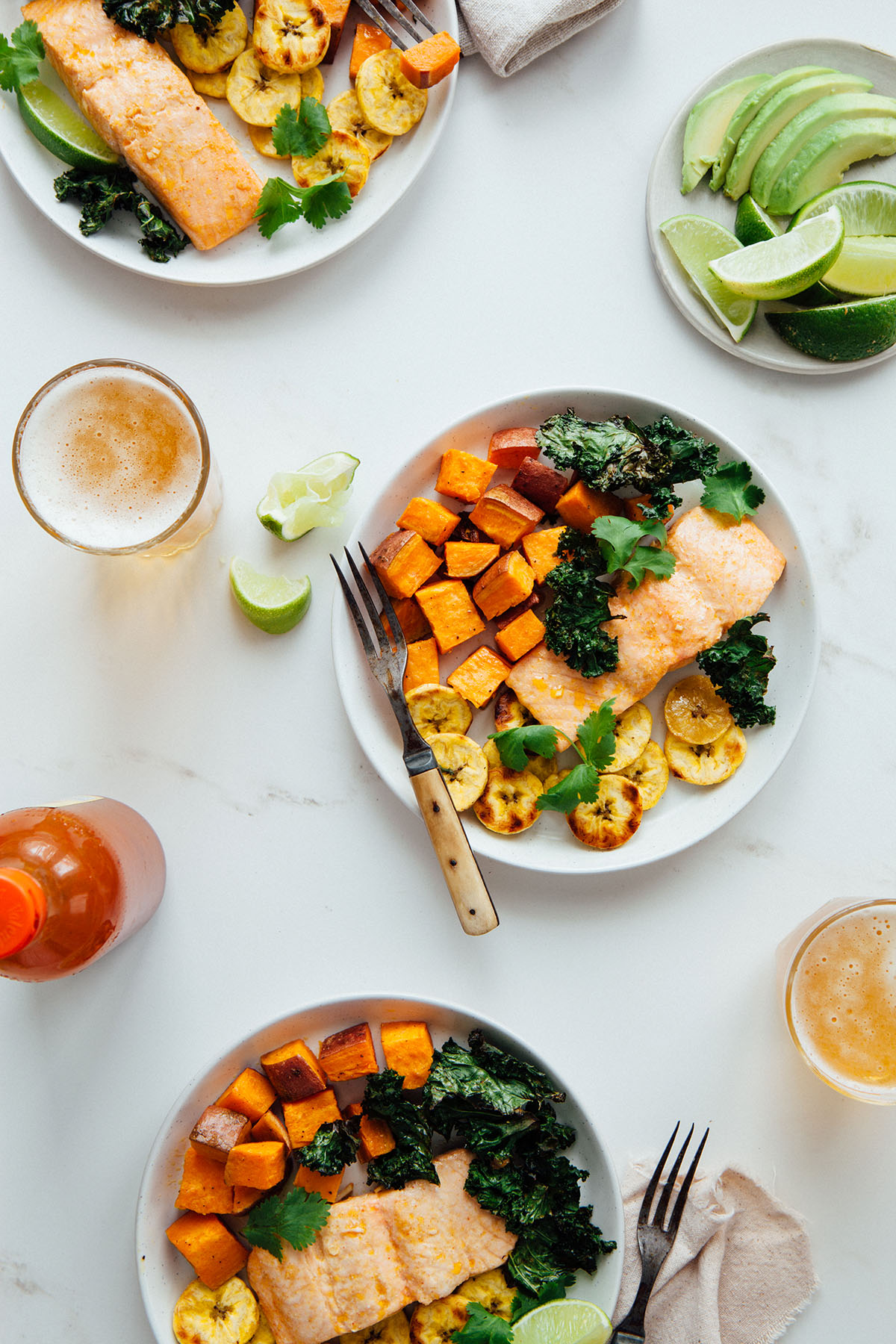 Cuban-inspired sheet pan salmon with roasted plantains, sweet potatoes, and kale chips.