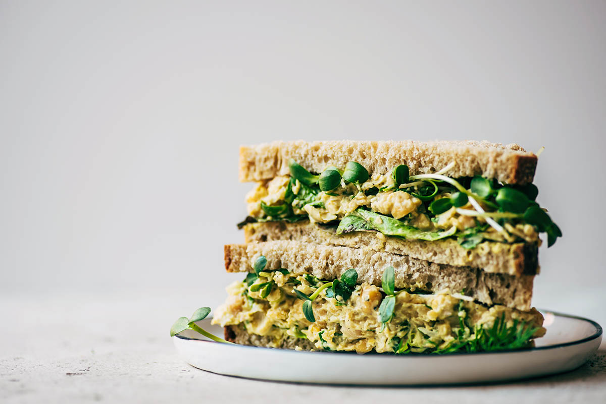 Close up cross section of a stacked chickpea salad sandwich