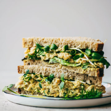Close up of a halved chickpea salad sandwich.