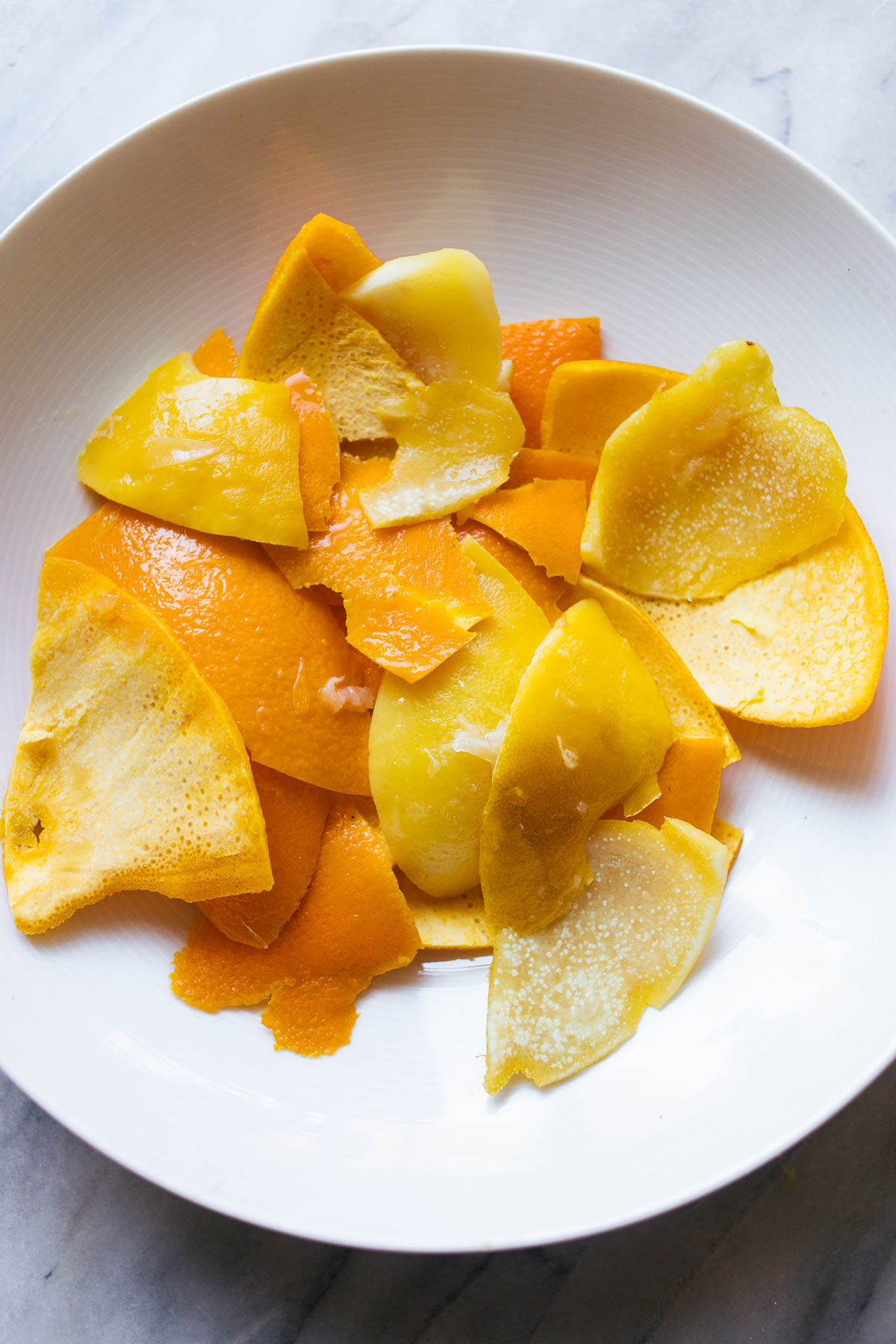 Candied orange and lemon peel on a white plate.