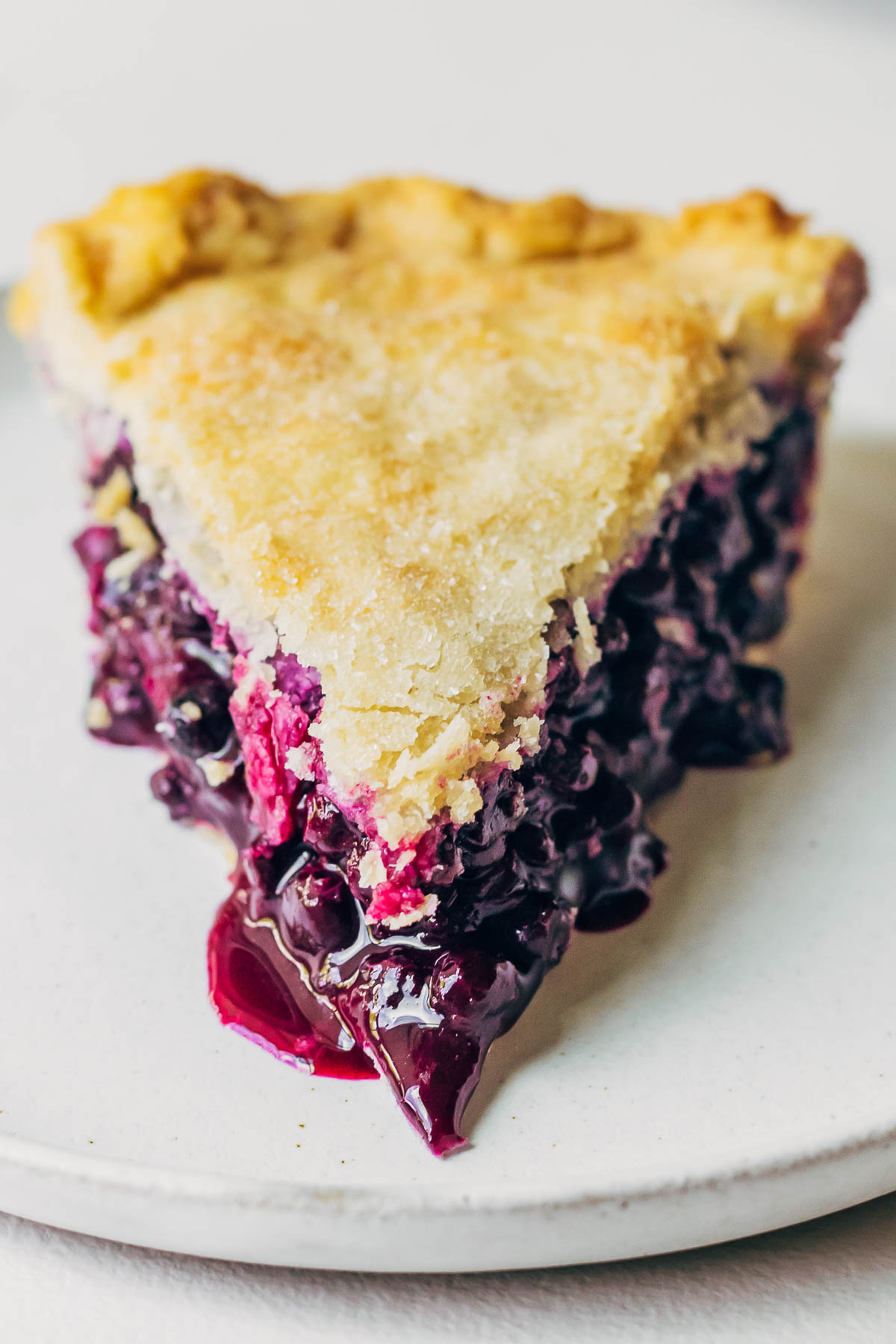 Close up of vegan blueberry pie on a plate.