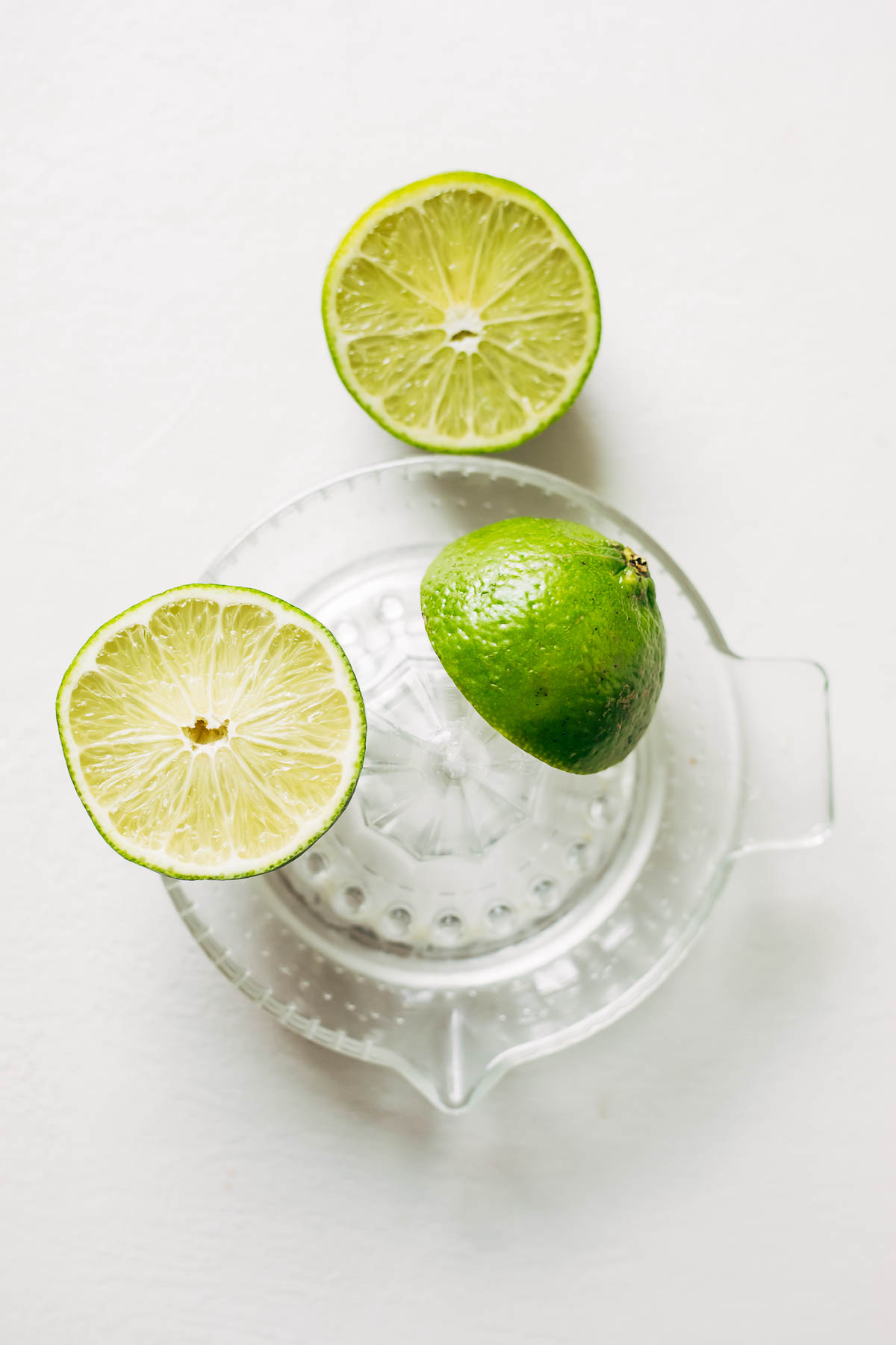 Lime halves on a glass juice extractor.