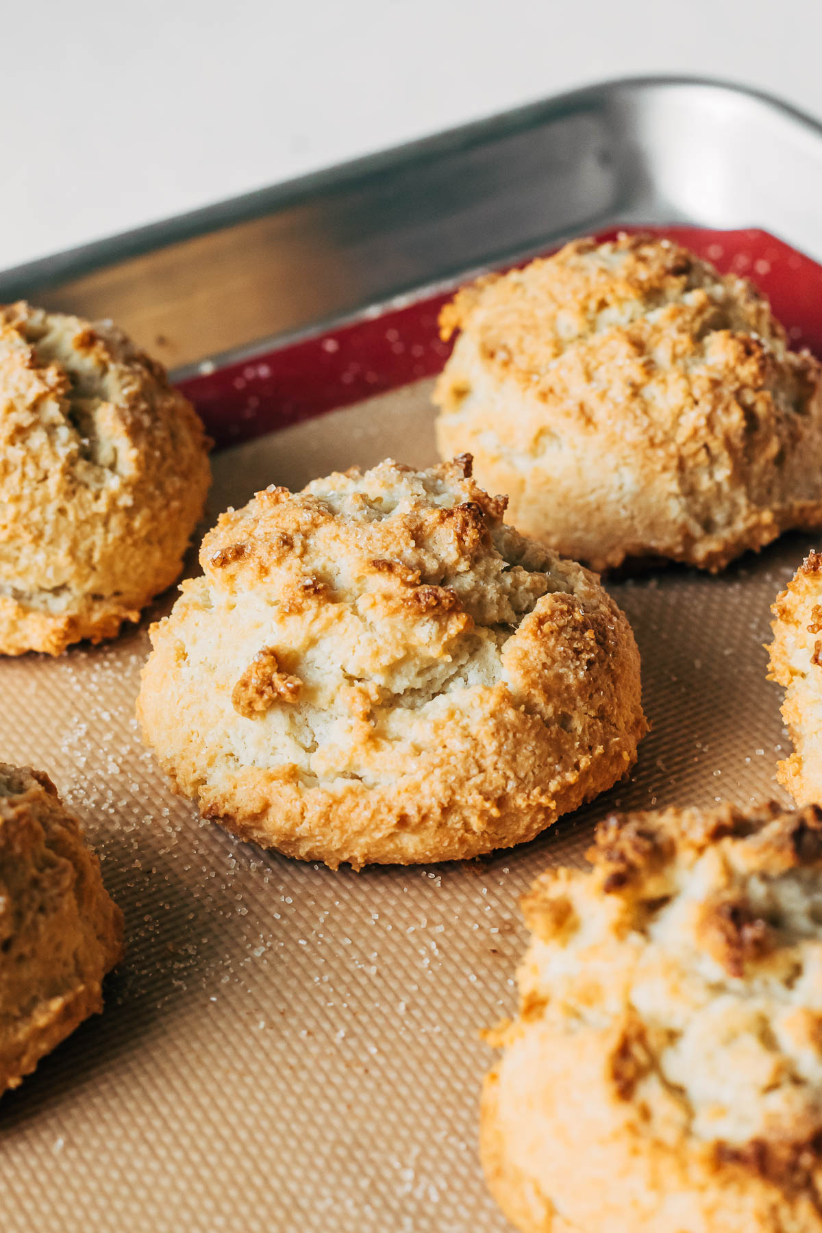 Baked almond flour biscuits on a baking sheet.