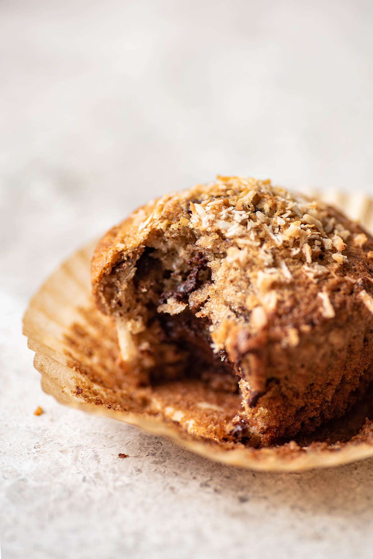 Close up of a chocolate chunk banana muffin to show internal texture.