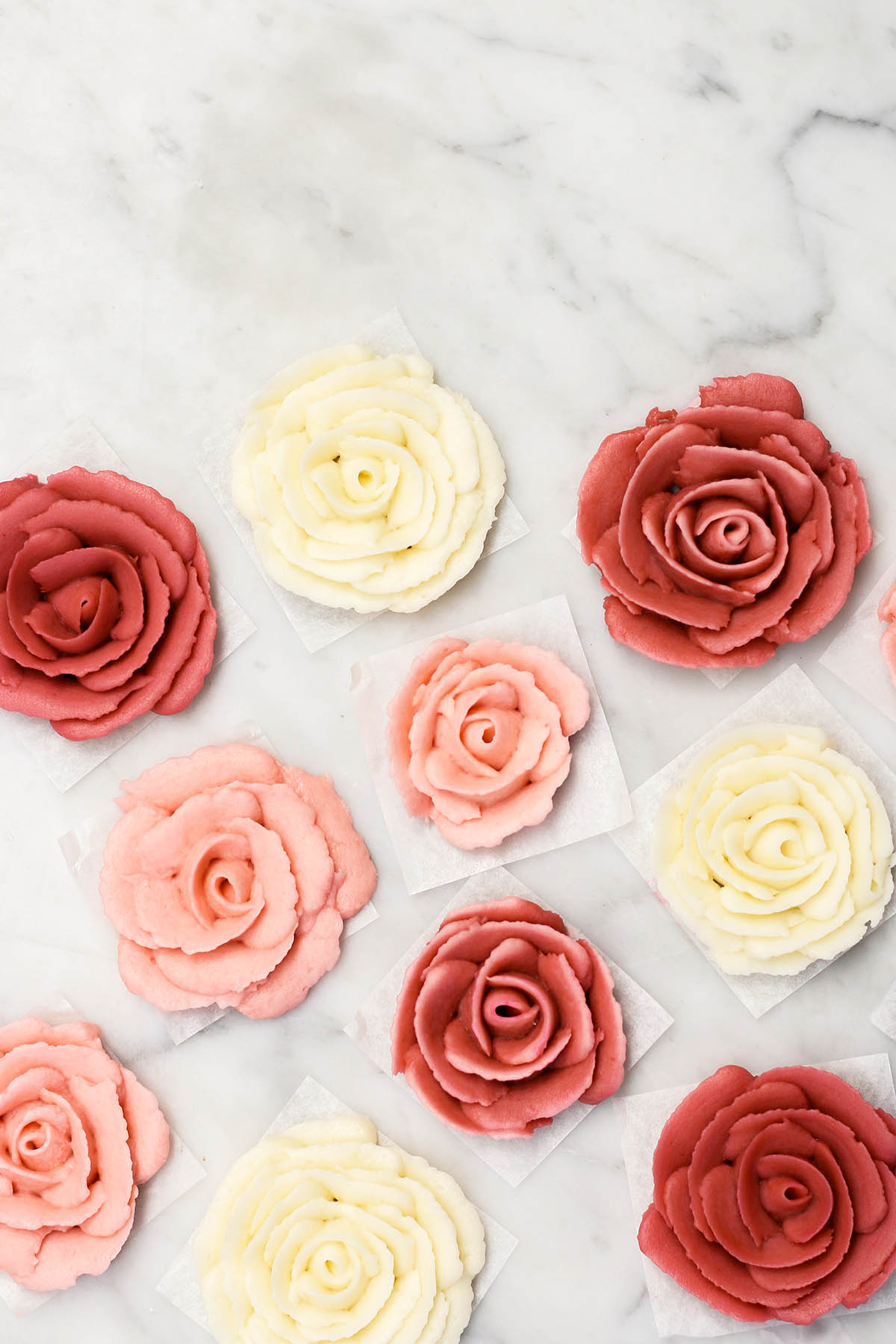 Buttercream roses on a marble background.