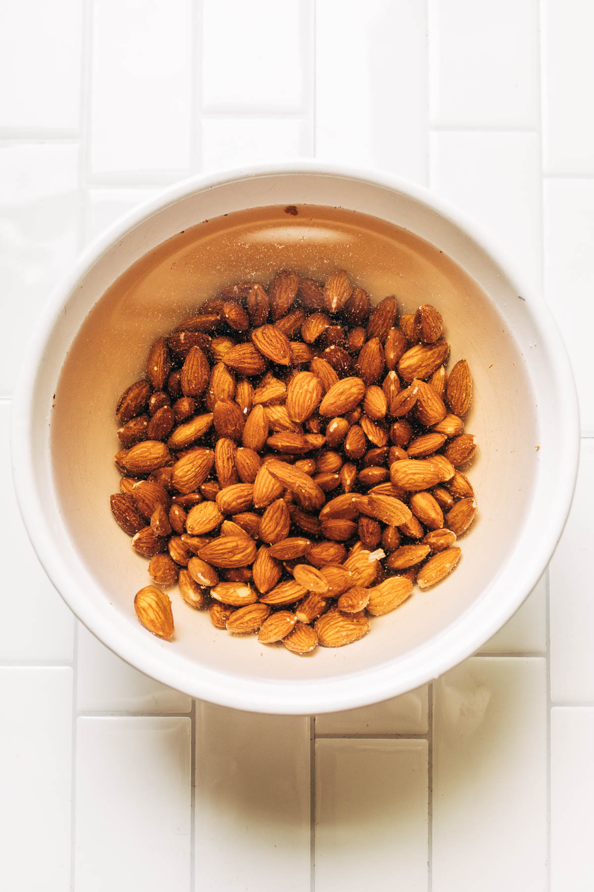 A bowl of almonds soaking in water.