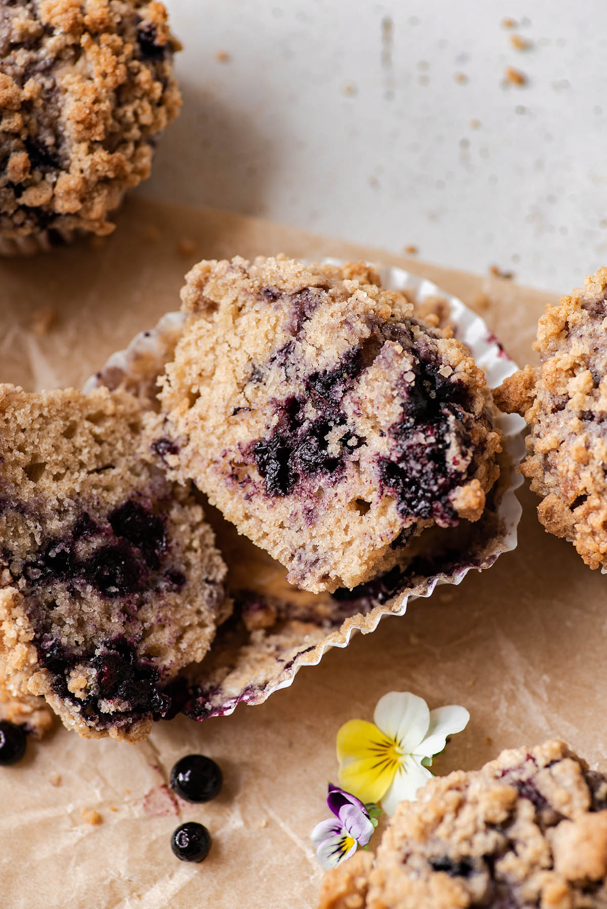 Blueberry streusel muffin cut in half to show interior texture.