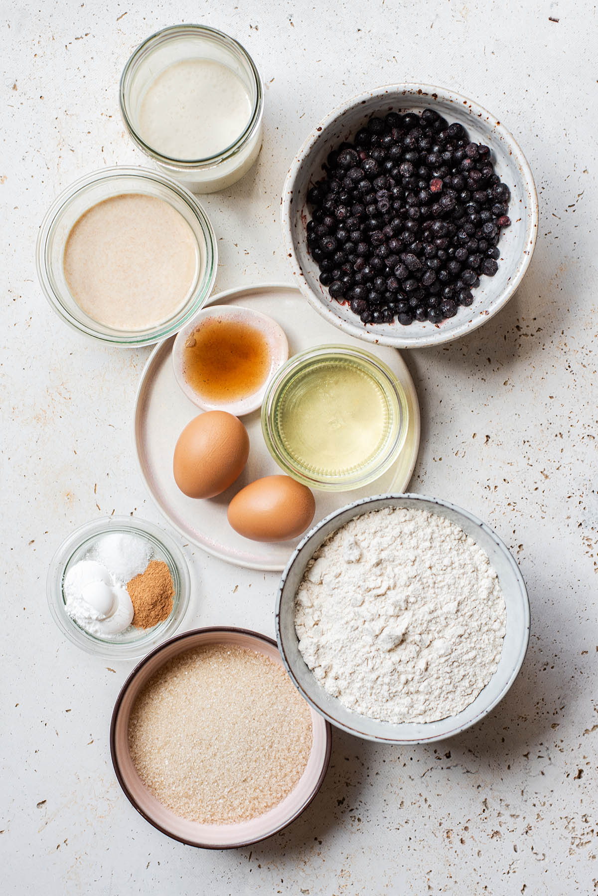 Sourdough blueberry muffin ingredients as a flat lay.