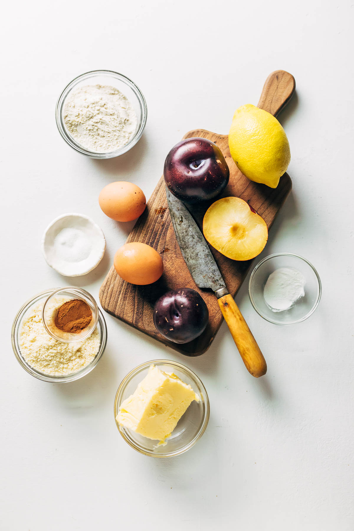 Overhead shots of ingredients needed to make a plum torte.