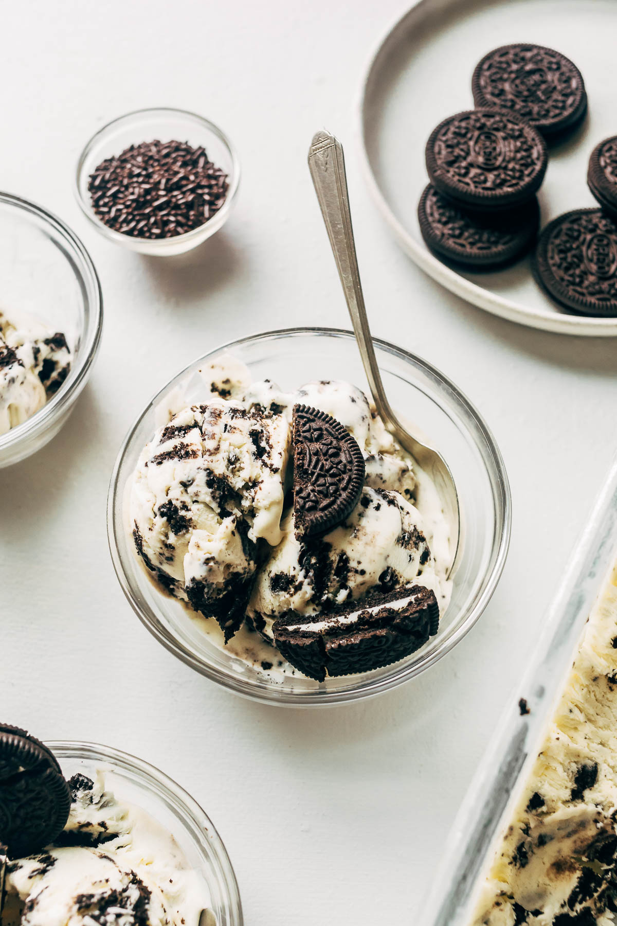 A dish of ice cream with Oreo cookies on top.