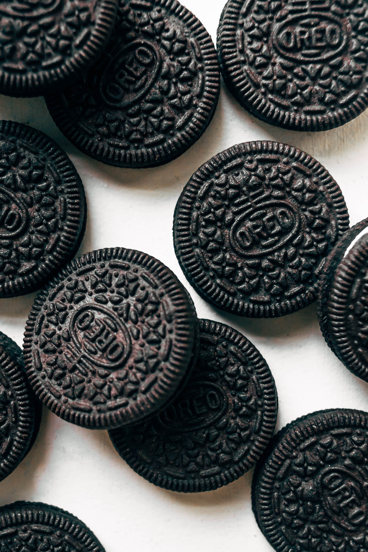 Overhead shot of Oreo cookies on a white surface.