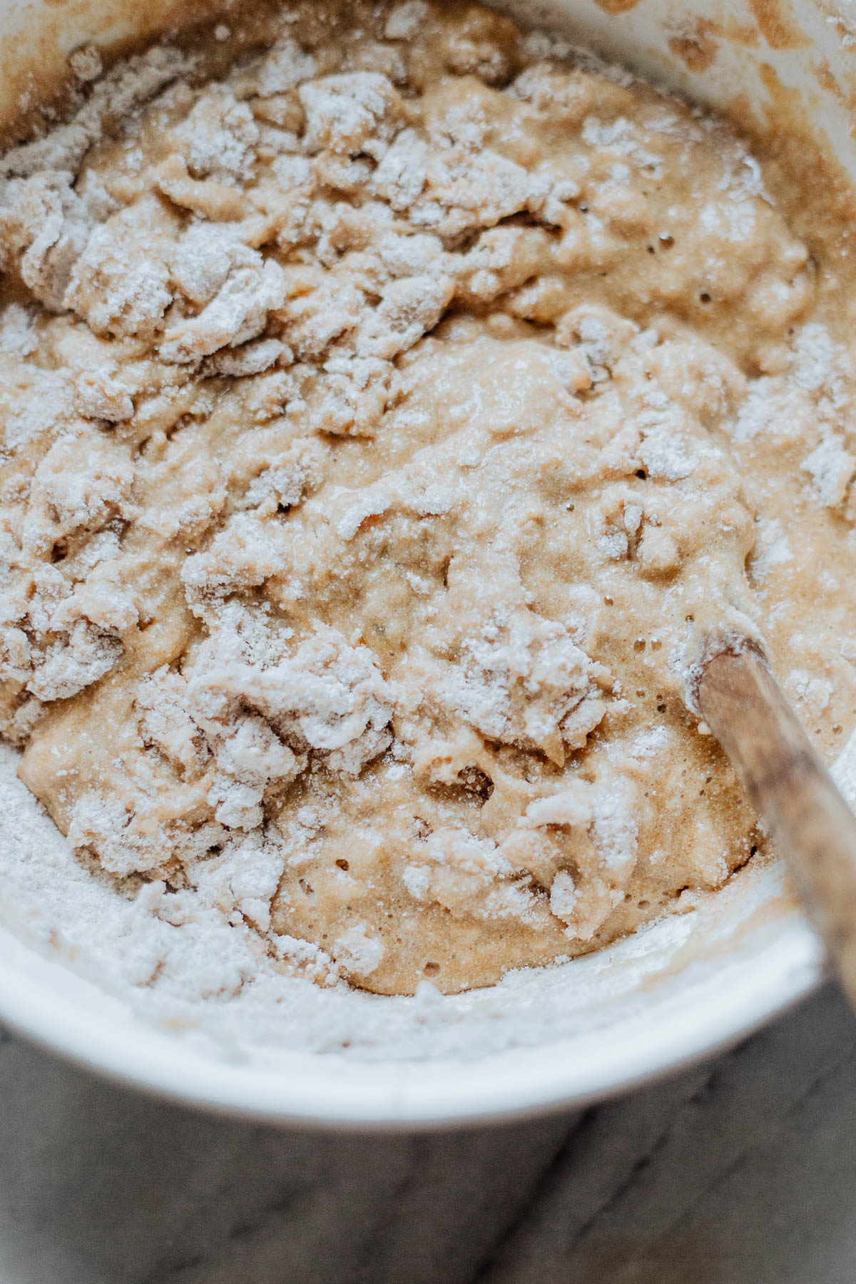 A bowl of unmixed muffin batter.