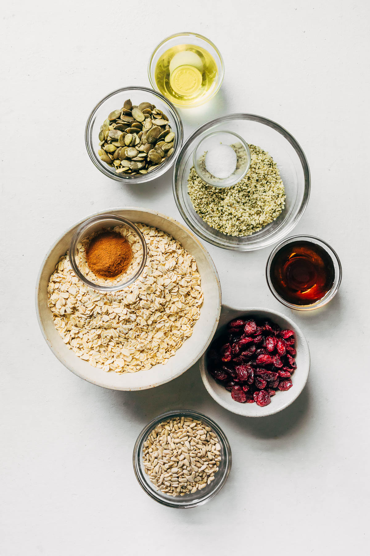Ingredients to make homemade granola with seeds and maple syrup.