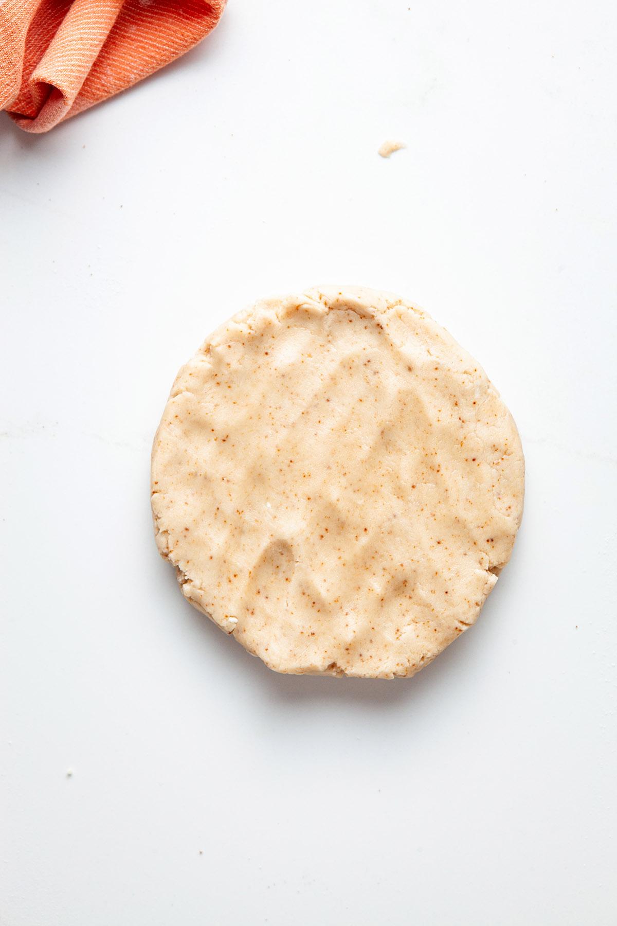 Coconut oil pie dough in a disc.