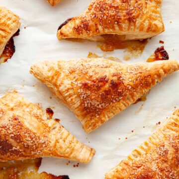Peach turnovers on a baking sheet.