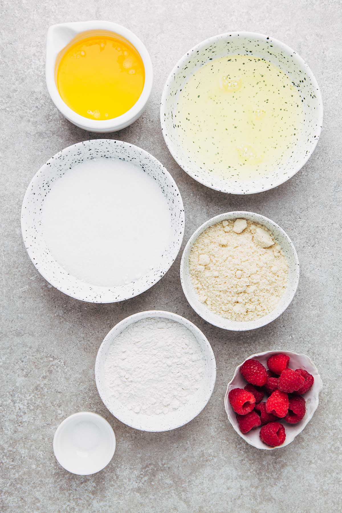 Raspberry financier ingredients in a flat lay.