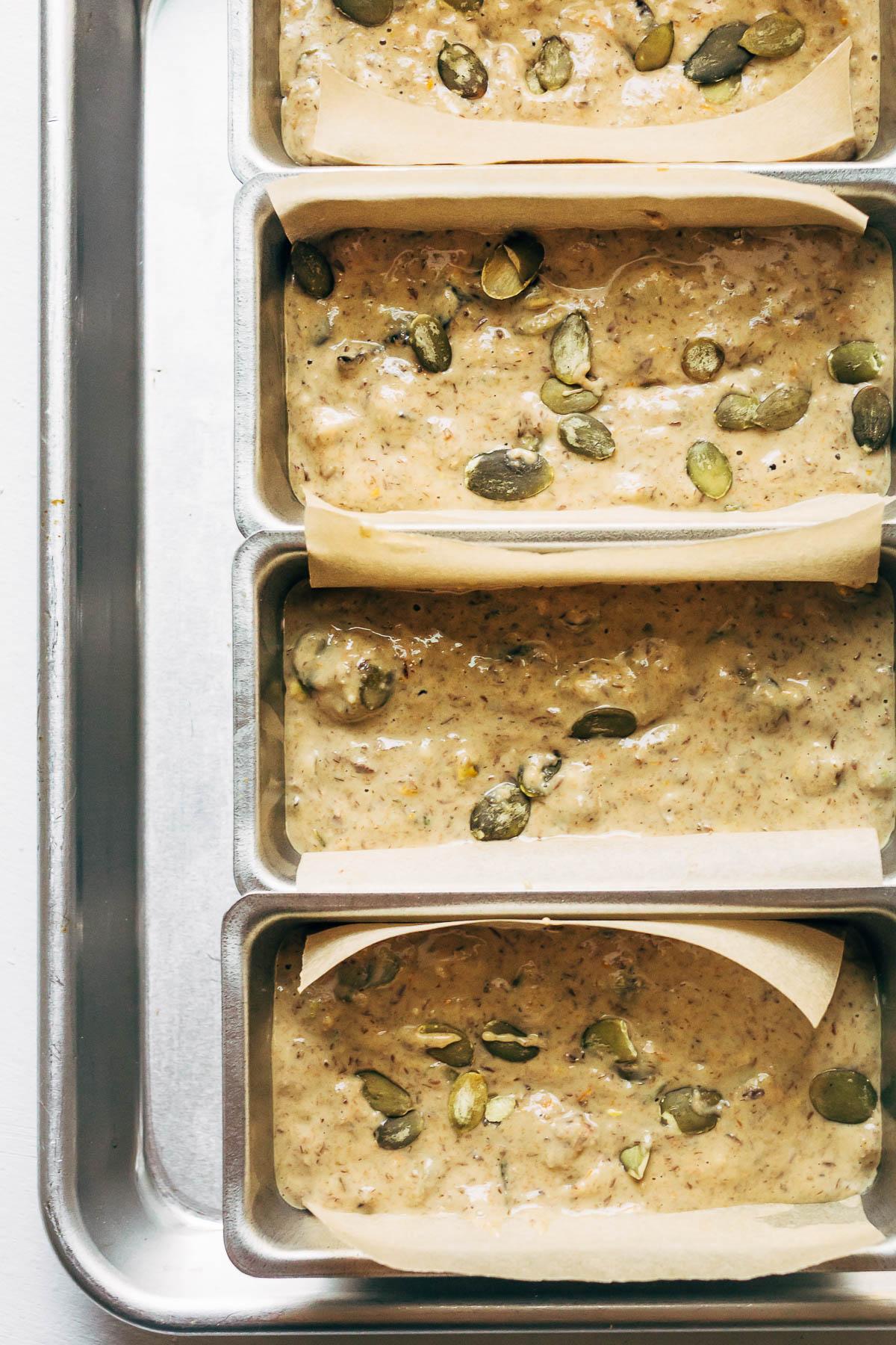 Cracker batter in lined mini loaf tins.
