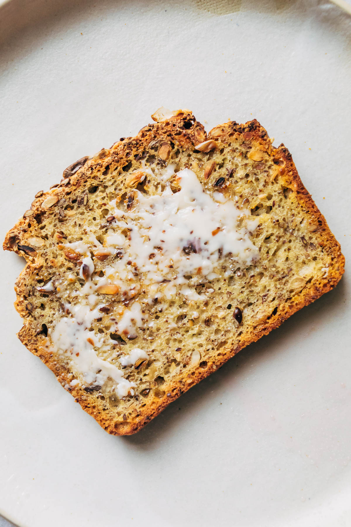 A buttered piece of gluten free toast.