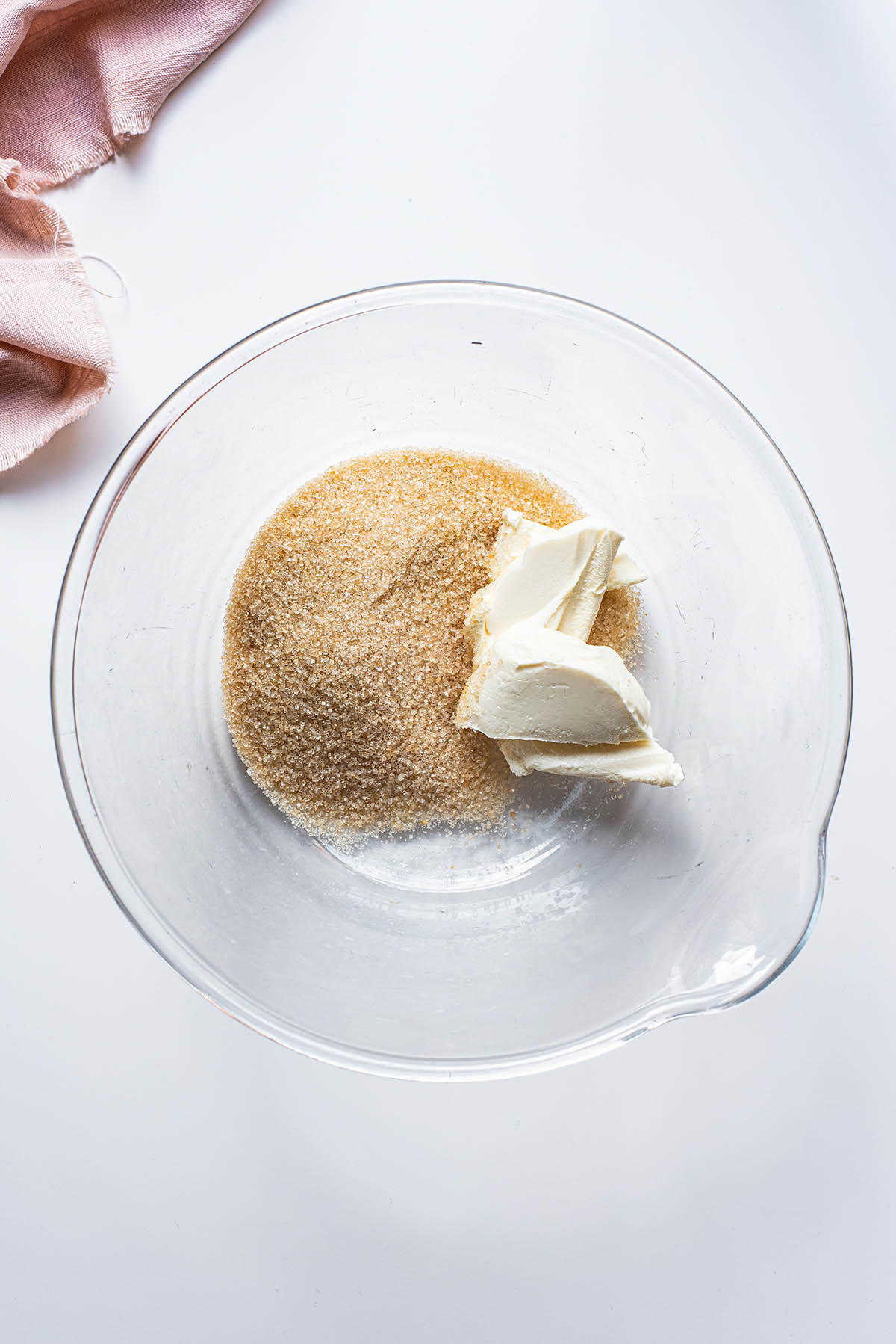 Vegan butter and sugar in a large glass bowl.