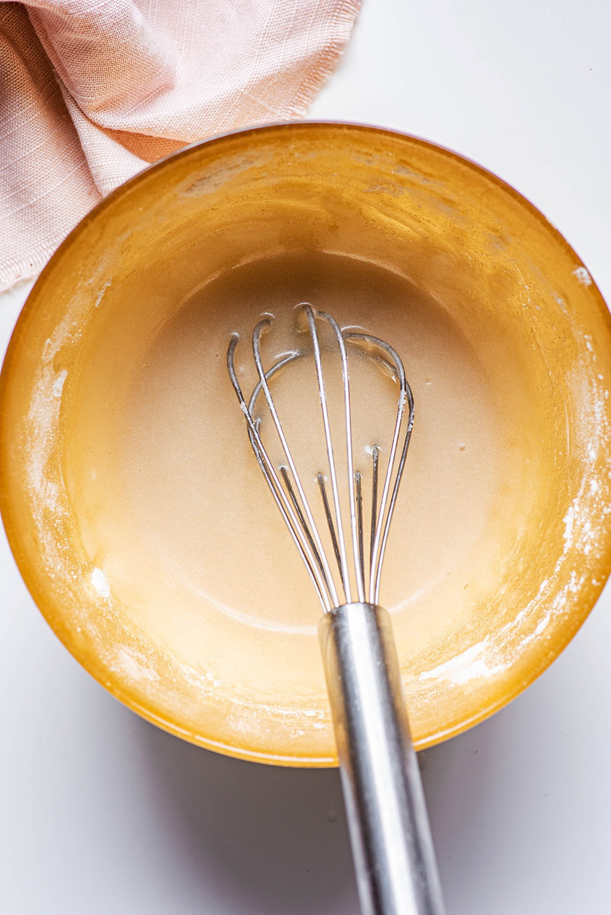 Glaze mixed with a whisk in the bowl.