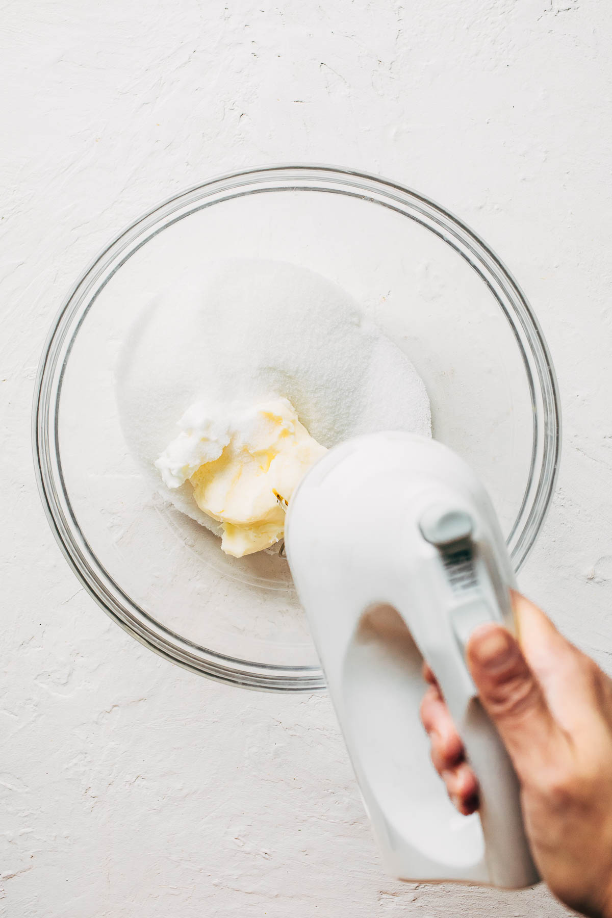Butter and sugar in a large glass bowl.