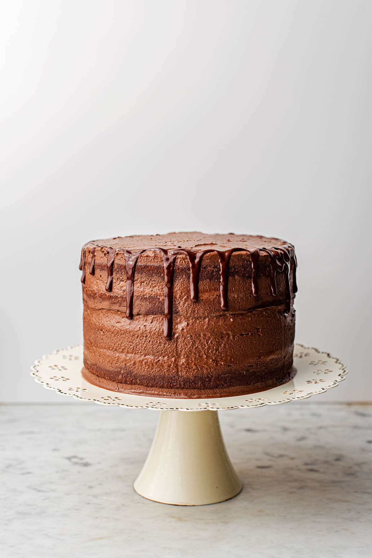 Finished chocolate layer cake with chocolate drip.