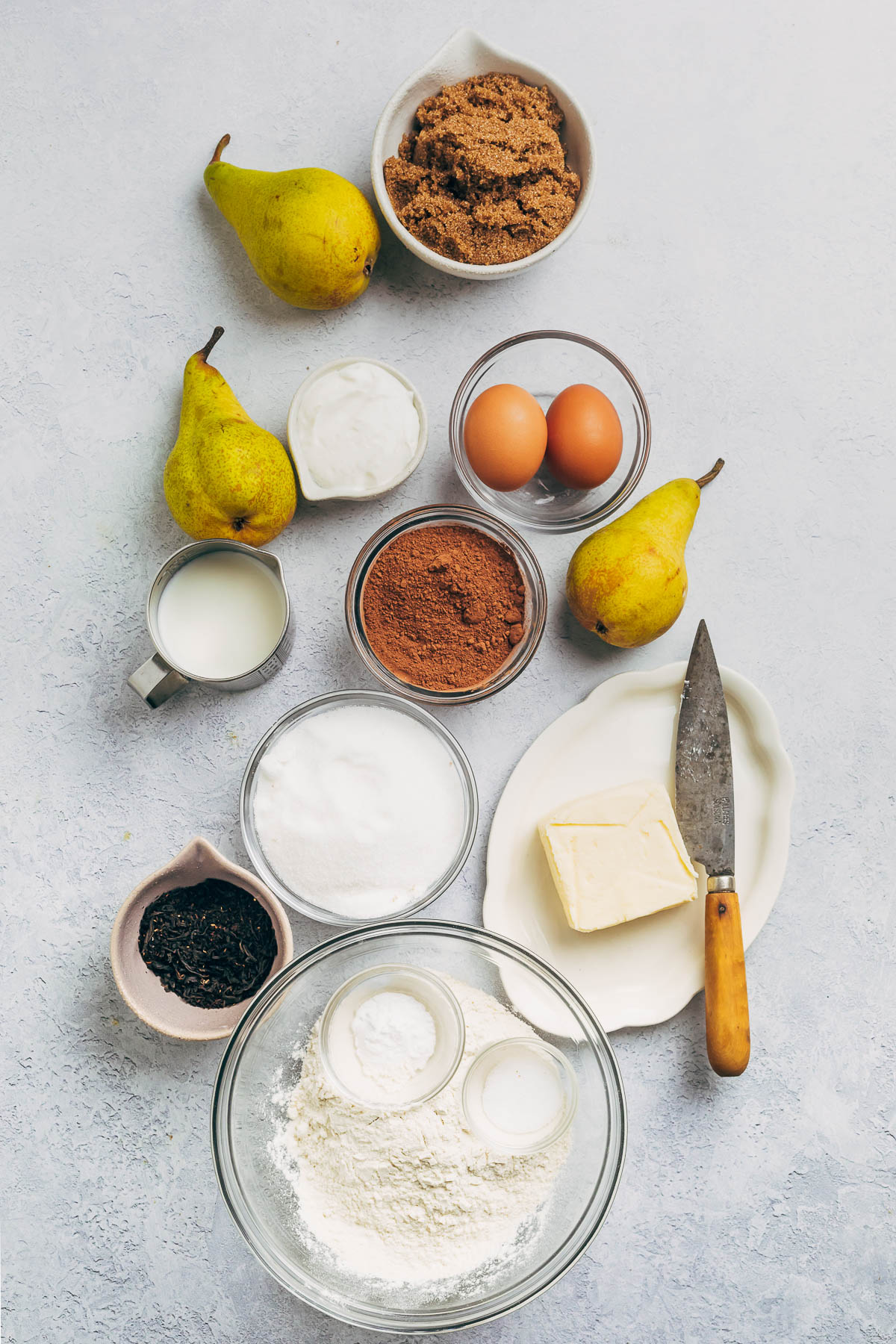 Ingredients to make a chocolate loaf cake with Earl grey-poached pears.