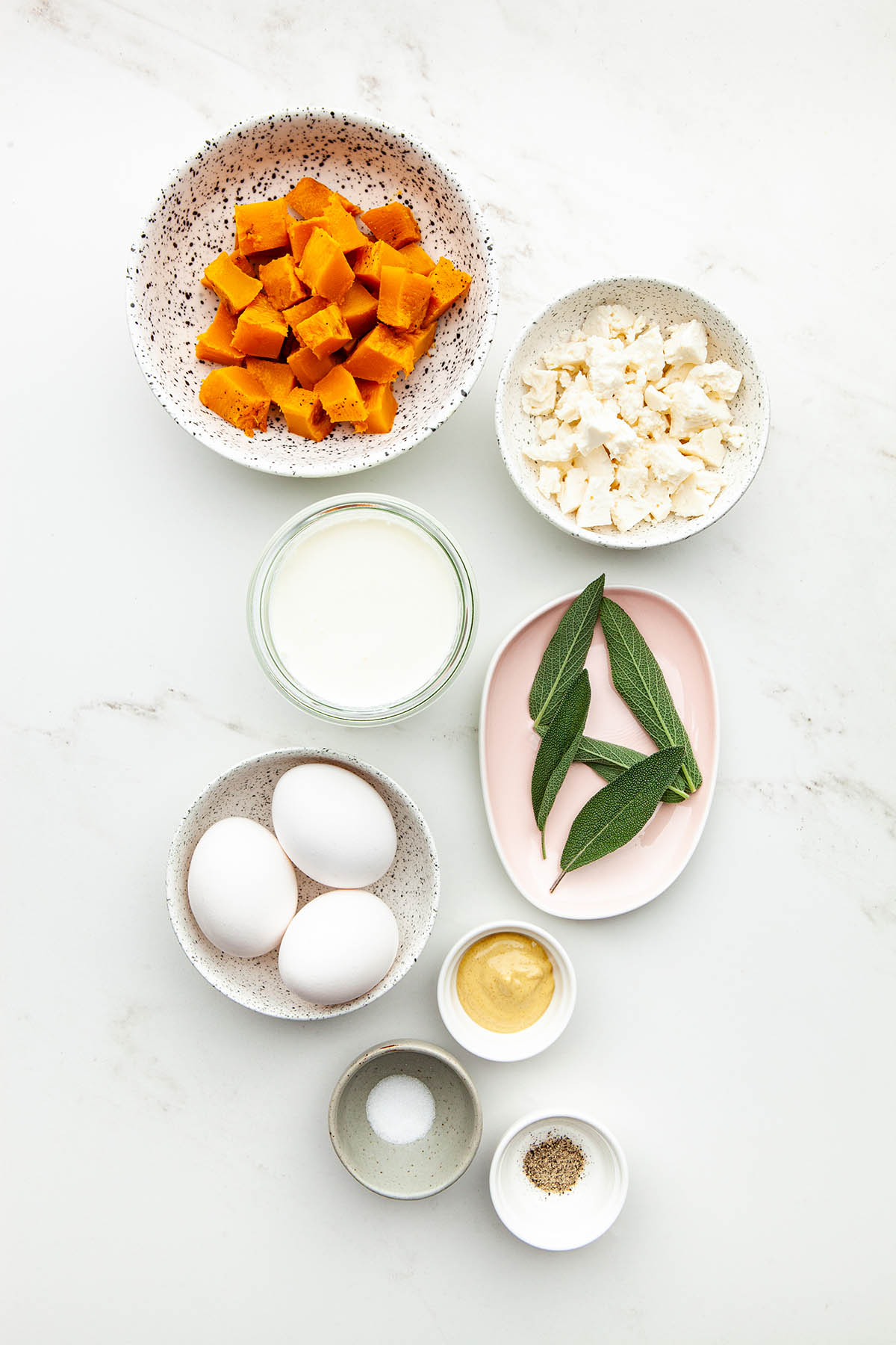 Ingredients to make pumpkin quiche.