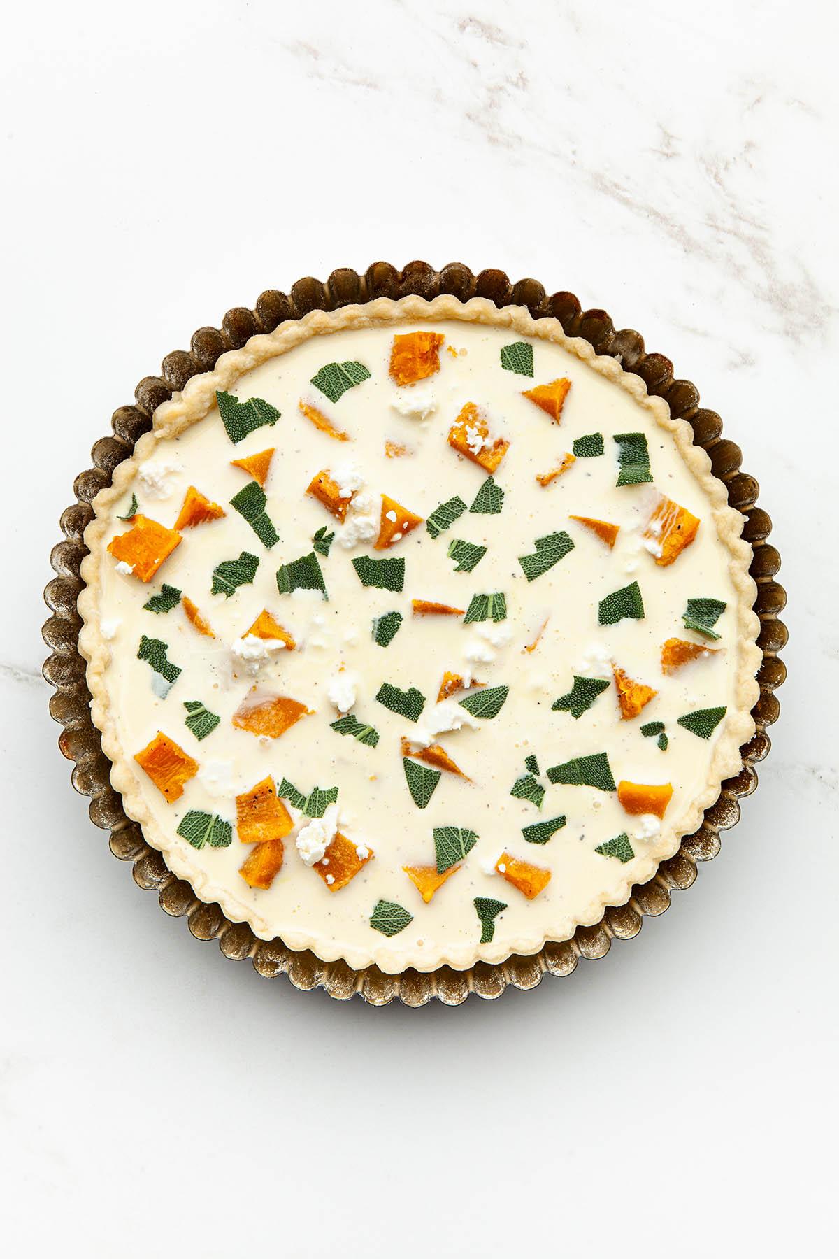An unbaked custard tart.