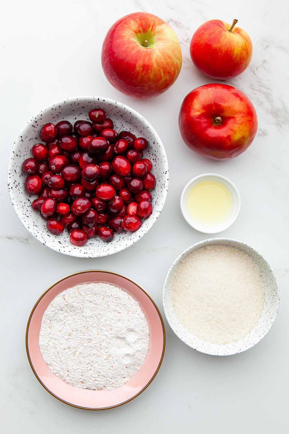 Ingredients to make cranberry apple crisp.