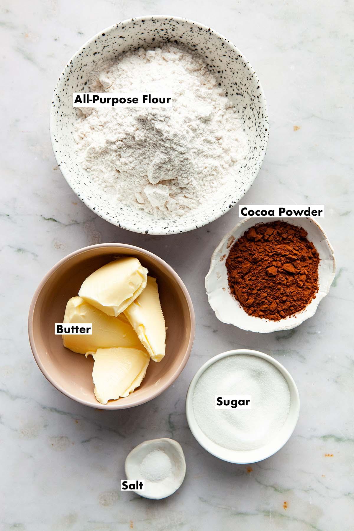 Ingredients to make chocolate shortbread sandwich cookies.