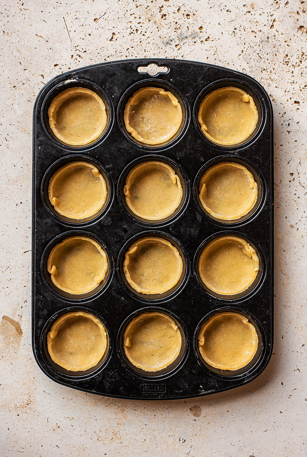Tart shells in the muffin tin.