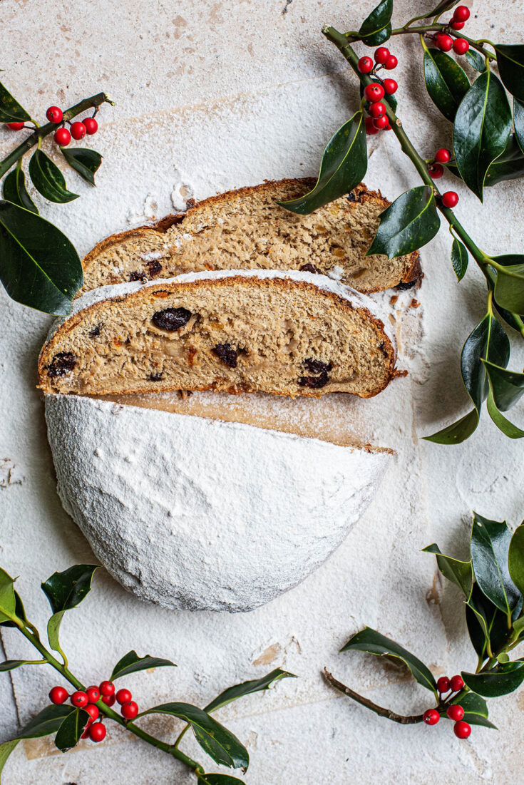 Top down view of sliced stollen with holly.