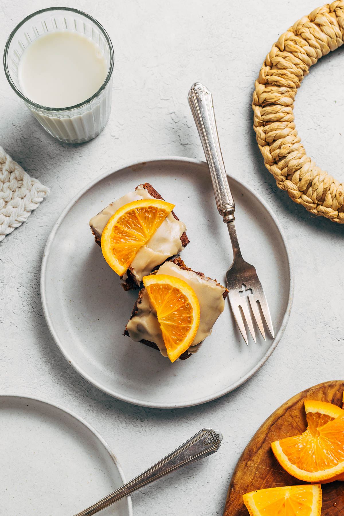 Two small pieces of cake topped with orange slices.