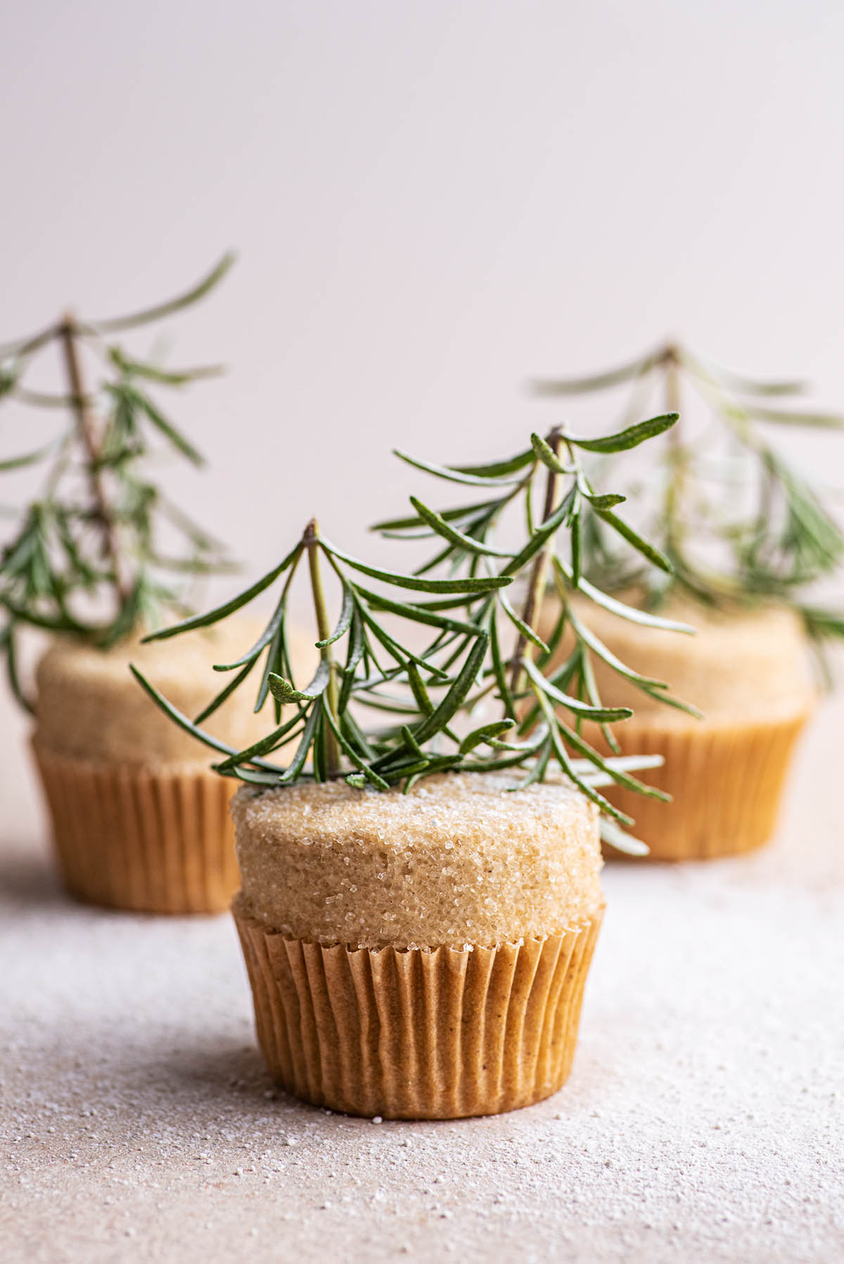 Three rosemary-topped cupcakes.
